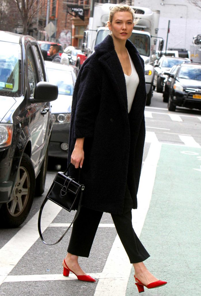 Karlie Kloss wears a navy Max Mara teddy coat. Celebrity winter coats. teddy bear coat