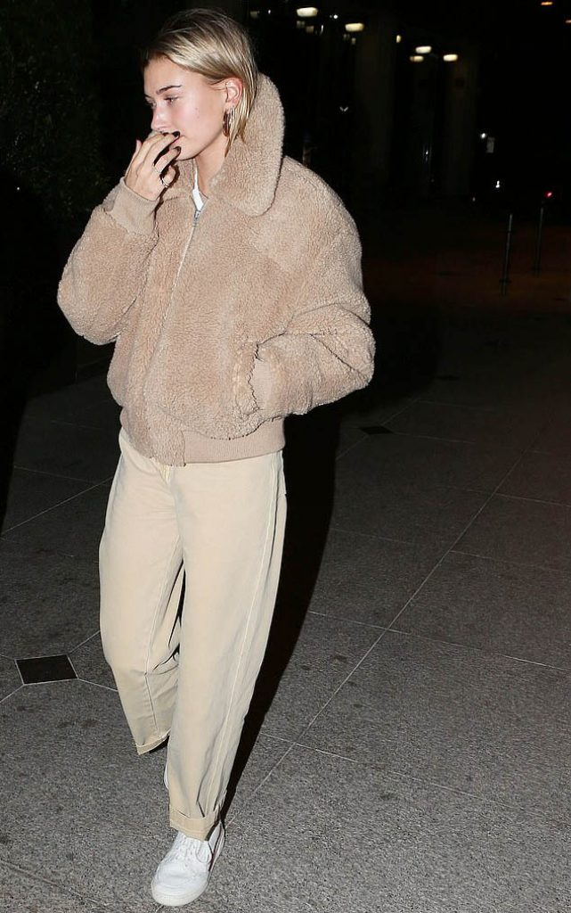 Hailey Bieber wears Wilfred Free The Teddy Jacket Zip-up Sherpa Jacket, teddy coat, teddy bear coat, celebrities wearing winter coats