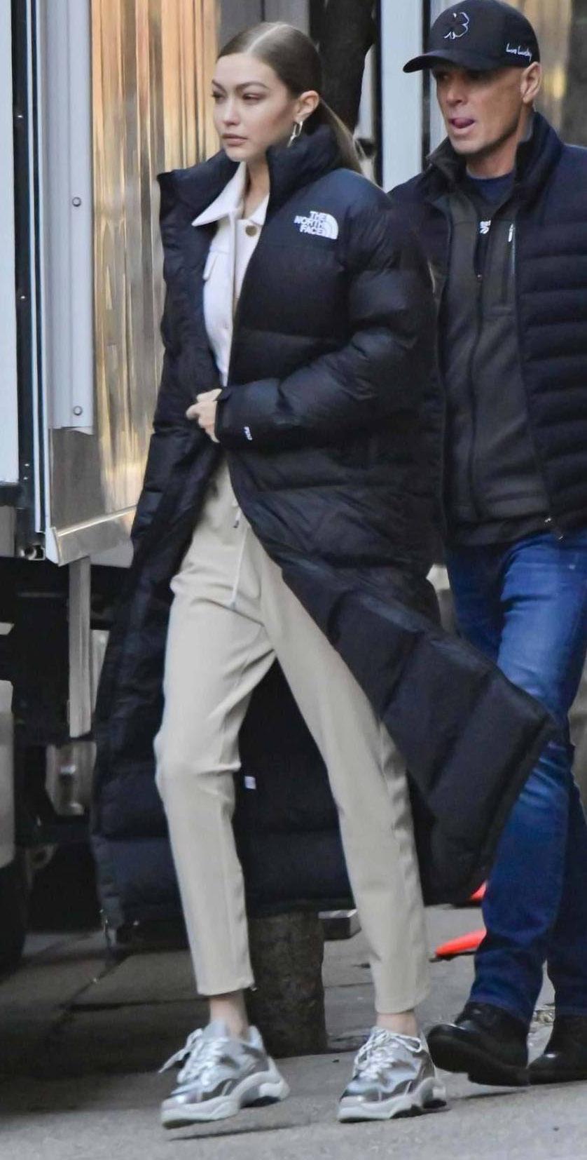 Gigi Hadid wearing long puffer coat. The North Face Nuptse Duster coat.