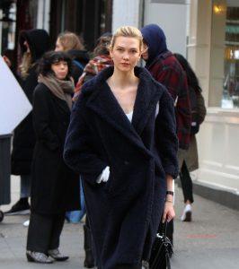 Karlie Kloss wears a navy Max Mara teddy coat. Celebrity winter coats. teddy bear coat