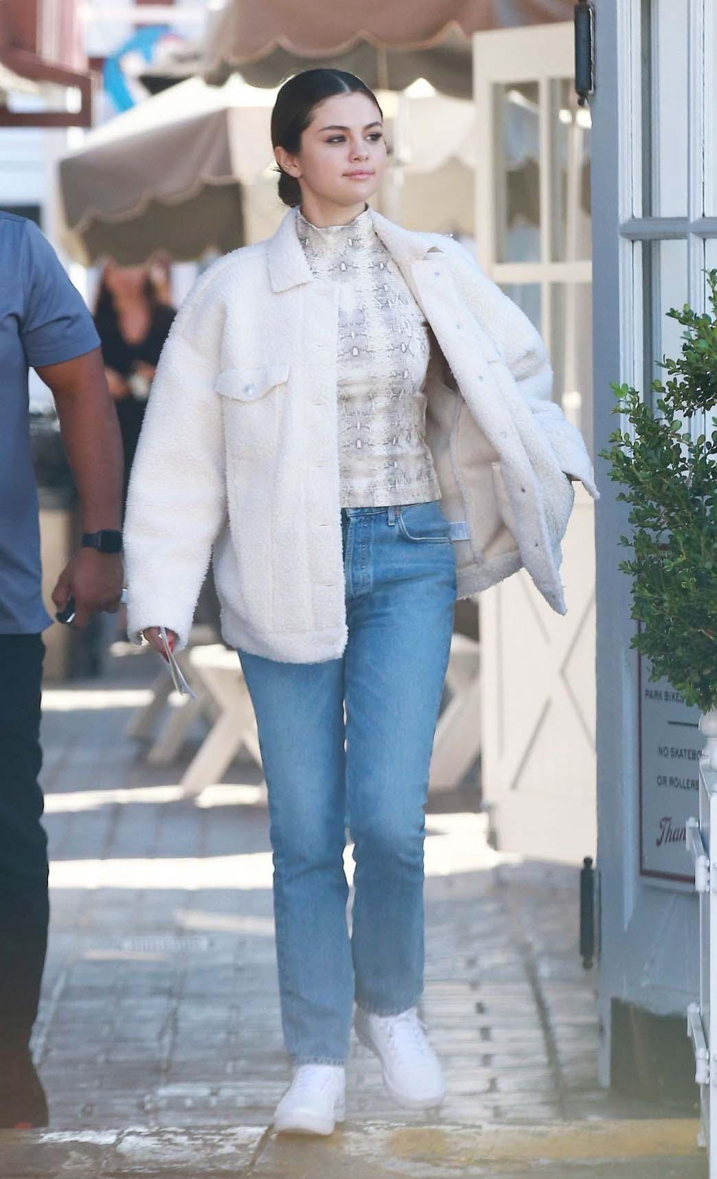 Selena Gomez wearing American Eagle Faux Sherpa Jacket, celebrity winter coats, celebrity winter jackets, Selena Gomez