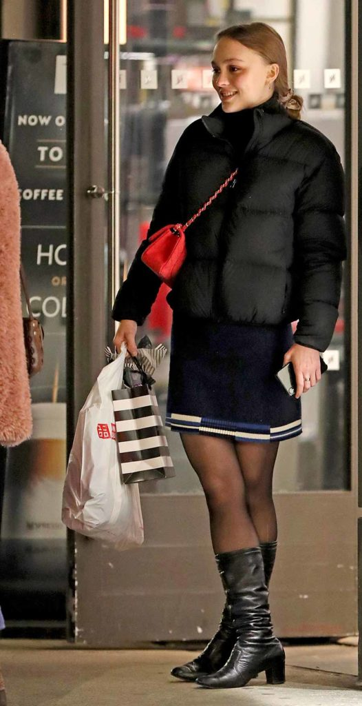 Lily Rose Depp wearing Aritzia Tina Park City Puffer Jacket, celebrities wearing winter coats