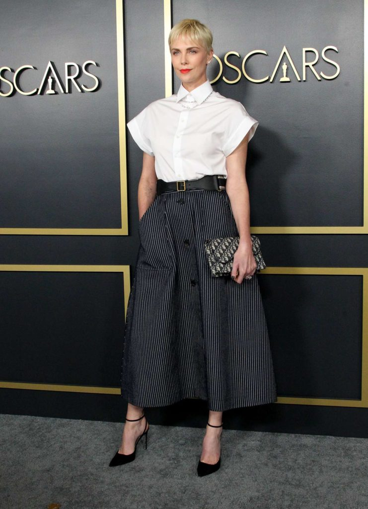 black skirt white top, diamond tennis necklace, diamond stud earrings, Charlize Theron, Christian Dior, skirt outfits