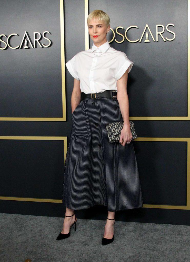 black skirt white top, diamond tennis necklace, diamond stud earrings, Charlize Theron, Christian Dior, skirt outfits