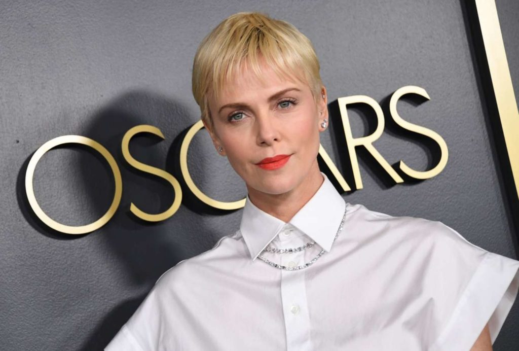 white top, black skirt, skirt outfits, diamond tennis necklace, diamond stud earrings, charlize theron, christian dior